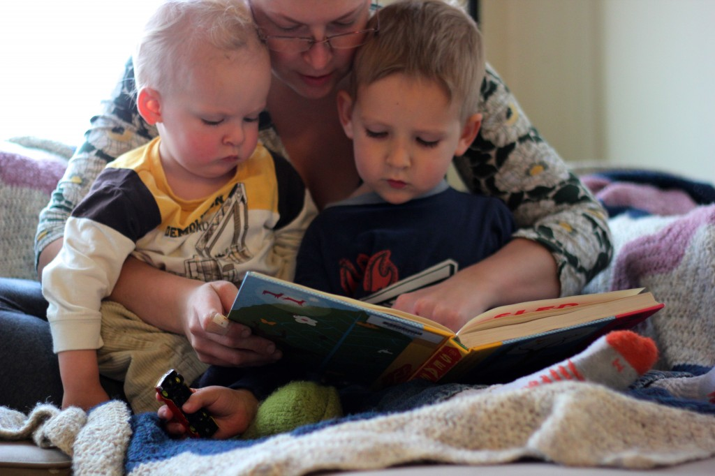 mom reading young children